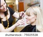 blond woman at the hair salon | Shutterstock . vector #75025528