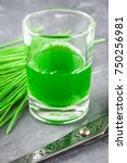 Small photo of Wheatgrass shot. Juice from wheat grass. Trend of health