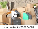 carton boxes with stuff in room.... | Shutterstock . vector #750266809