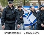 4th November 2017, London, United Kingdom:-Police officers march infron of Pro Israeli protestors to keep pro Palestine protesters away - stock photo