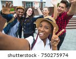 students with beaming smiles...   Shutterstock . vector #750275974