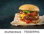 burger on a dark background   Shutterstock . vector #750305941