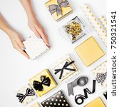 female hands holding present ... | Shutterstock . vector #750321541