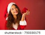 beautiful young woman in santa... | Shutterstock . vector #750330175