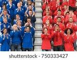 rival fans at football match | Shutterstock . vector #750333427