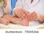 Doctor Massaging Little Baby's...