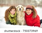 young couple with a dog on a... | Shutterstock . vector #750373969
