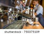 making a espresso and cappuccino | Shutterstock . vector #750375109