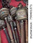 hand prayer wheels with wooden... | Shutterstock . vector #750401371