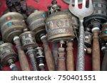 hand prayer wheels with wooden... | Shutterstock . vector #750401551