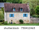 nise little house with blue... | Shutterstock . vector #750412465