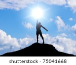 man on the mountain reaches for ... | Shutterstock . vector #75041668