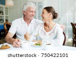 mature affectionate couple... | Shutterstock . vector #750422101