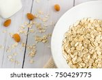 oats in white plate on wooden... | Shutterstock . vector #750429775