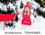 happy child in knitted reindeer ... | Shutterstock . vector #750495865