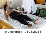 Small photo of HYDERABAD,INDIA-NOVEMBER 5:Nurse check Heart beat of a man using ECG machine and electrodes in a medical camp on November 5,2017 in Hyderabad,India.