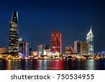 Ho Chi Minh City skyline and the Saigon River. Scenic colorful night view of skyscraper and other modern buildings at downtown. Ho Chi Minh City is a popular tourist destination of Vietnam.