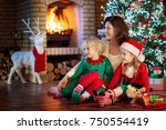 family with kids at christmas... | Shutterstock . vector #750554419