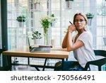 thoughtful female entrepreneur... | Shutterstock . vector #750566491