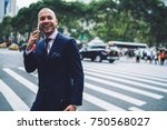 handsome cheerful manager... | Shutterstock . vector #750568027
