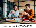 young male coworkers discussing ... | Shutterstock . vector #750569971