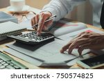 accountant working on desk...   Shutterstock . vector #750574825