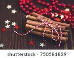 christmas cinnamon sticks tied... | Shutterstock . vector #750581839