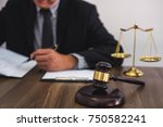 Gavel On Wooden Table And...