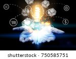 hand holding light bulb....   Shutterstock . vector #750585751