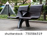 modern wooden bench in the park | Shutterstock . vector #750586519