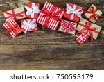 many christmas gifts on wooden... | Shutterstock . vector #750593179