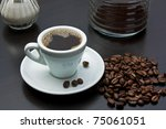 cup of black coffee and coffee... | Shutterstock . vector #75061051