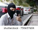 masked burglar wearing a... | Shutterstock . vector #750657604