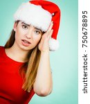 Small photo of Xmas, seasonal clothing, winter christmas concept. Young shocked worried woman wearing Santa Claus helper costume