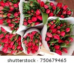 bouquets of red tulips on a...
