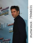 """Small photo of NEW YORK - MAR 27: John Stamos arriving at the """"How To Succeed In Business Without Really Trying"""" premiere at the Al Hirschfeld Theatre in New York, NY on March 27, 2011."""