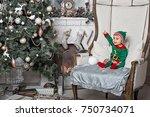 Little Boy In Elf Costume...