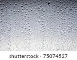 drops on a glass surface  grey... | Shutterstock . vector #75074527