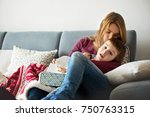 young mother  holding her... | Shutterstock . vector #750763315