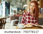 girl in a cafe | Shutterstock . vector #750778117