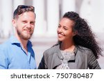 young multiracial couple with... | Shutterstock . vector #750780487