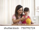 mother and daughter counting... | Shutterstock . vector #750792724