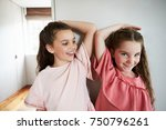 two sisters comparing height...   Shutterstock . vector #750796261