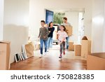 family carrying boxes into new... | Shutterstock . vector #750828385
