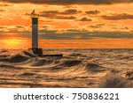 lighthouse and pier on a stormy ... | Shutterstock . vector #750836221