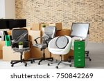 Small photo of Carton boxes with stuff in empty room. Office move concept