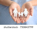 woman holding wooden figure of... | Shutterstock . vector #750843799