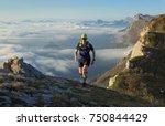 athlete trailrunning in the... | Shutterstock . vector #750844429