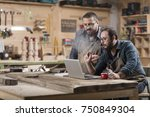 two wood designer working with...