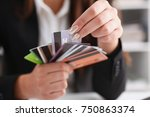 female arm hold bunch of credit ... | Shutterstock . vector #750863374